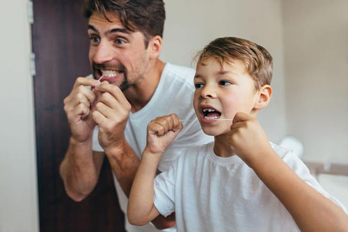 father-son-flossing