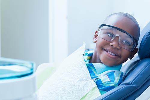 smiling-boy-waiting-for-dental-exam