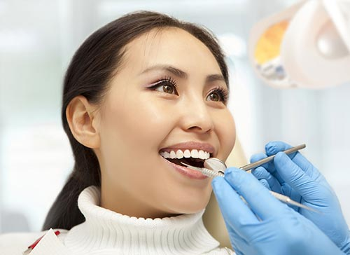 woman-smiling-at-dentist-teeth-cleaning