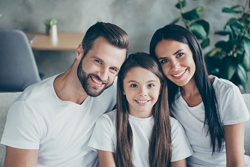 family of three big smiles