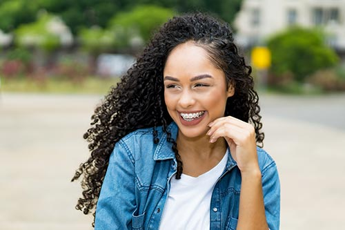 young-woman-smiling-outside-wearing-braces