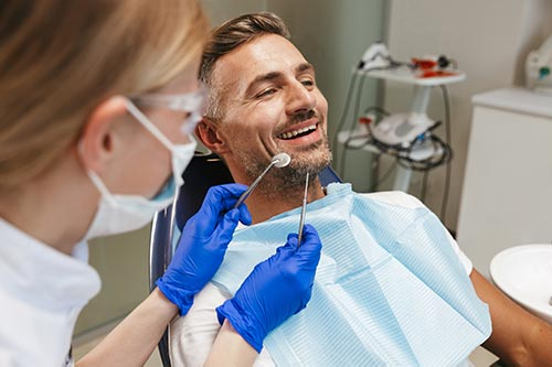 middle-aged-man-in-dentists-chair