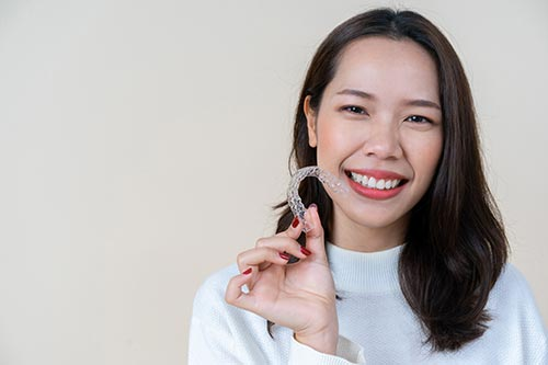 young-woman-with-invisalign-clear-aligners